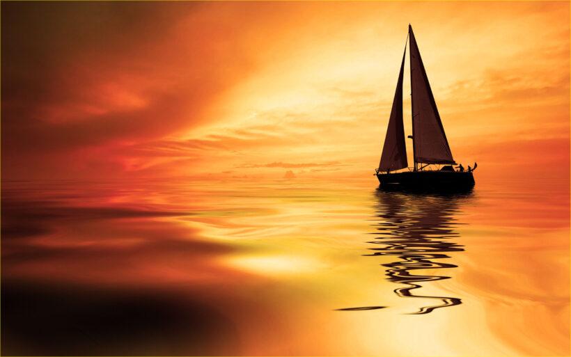 Hình ảnh thuyền buồm in bóng trên mặt biển