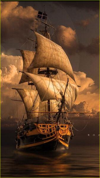 Hình ảnh thuyền buồm lênh đênh trên biển ban đêm
